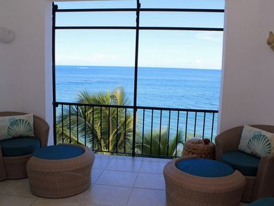 Photo for Top-floor beachfront condo with elevator, sea views, visitors friendly