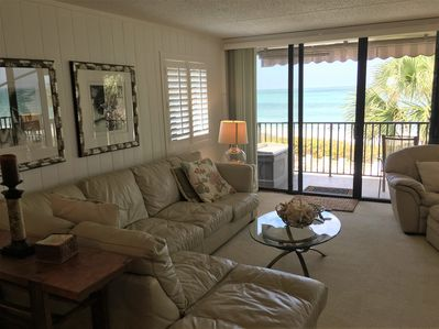 View of Living Room with full wall of sliding glass doors to porch.