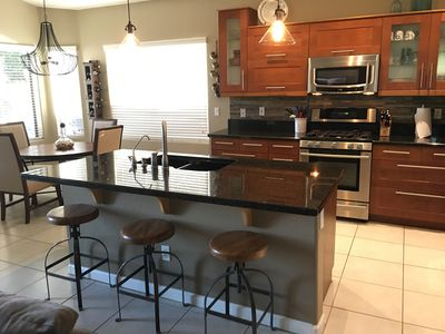 Gorgeous kitchen with granite counter tops and  stainless steel appliances