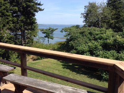 Photo for Beautiful log cabin steps from the beach! Ocean Front!