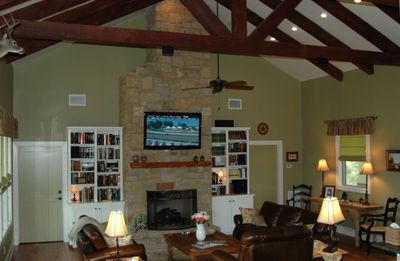 """Living Area 22' ceilings with hand hewn beams, leather furniture, 54"""" HDTV"""