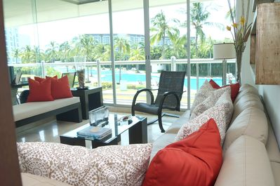 Living room with pool view