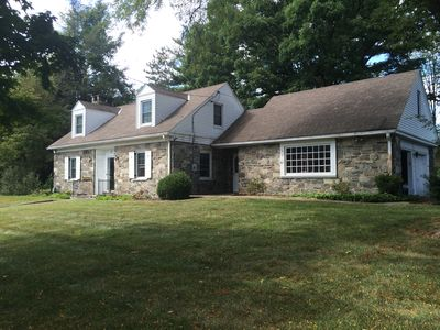 Photo for Classic Stone House on Quiet Street - Walking Distance to Main Street!