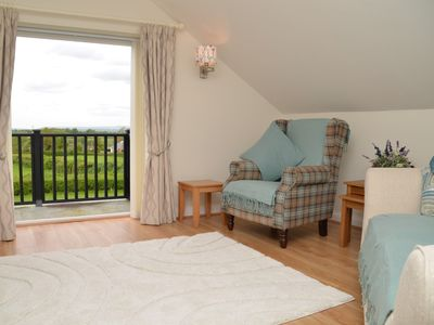 Enjoy countryside views from the lounge and balcony