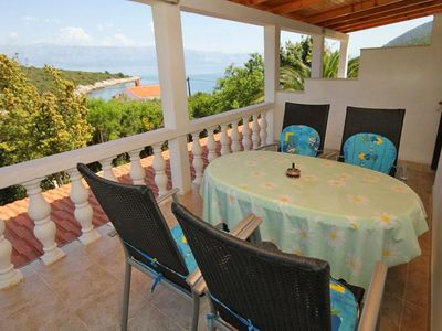 Photo for Two bedroom apartment with terrace and sea view Cove Zarace (Gdinj) (Hvar)