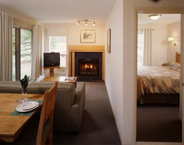 Photo for Rustic Budget Banff Condo with Fireplace | Access to 2 Hot Tubs!
