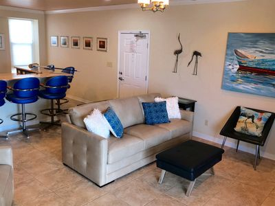 Your paradise awaits!  Living room- all new furniture with queen sleeper.