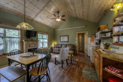 Great room with full kitchen, queen sleeper, dining table for six, fireplace