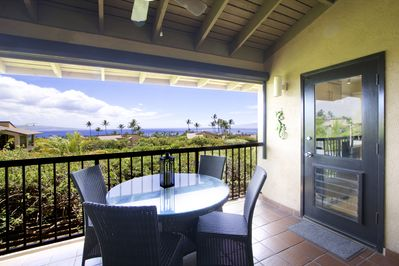 Spacious lanai and modern dining furniture, with an ocean view!