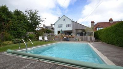 Photo for 5 bed, heated pool May-mid Oct, walk to beach, sea views, modern family house