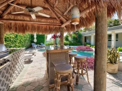 Photo for Harbourside 4 - Lush Tropical Get-Away/Steps to Beach/Walk to Nightlife/Pool & Hot Tub/Tiki BBQ Area