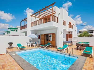 Photo for 2 bedroom Villa, sleeps 4 in Puerto del Carmen with Pool, Air Con and WiFi