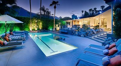 Lap pool & lounge area at dusk