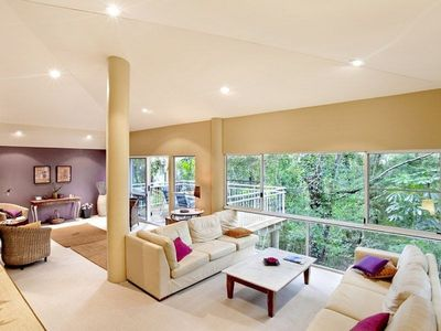 Open plan living area, comfortable furnishings overlooking the rain forest