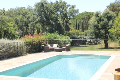 Relax beside the pool set in beautiful gardens