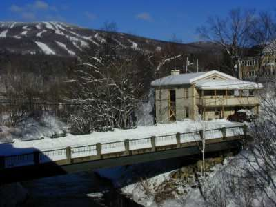 The River house many years ago with some gorgeous snowy slopes in the background