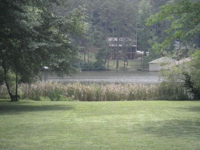 1 acre back yard leads directly to water. Boathouse with 1 boat slip. Fire pit