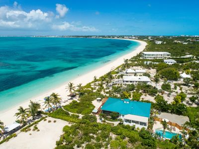 Photo for Conch Beach Villa - Directly on Grace Bay Beach! Tennis Court, Kayaks & More!