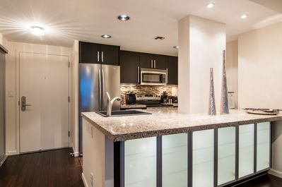 Granite counters & stainless steel appliances throughout the kitchen.