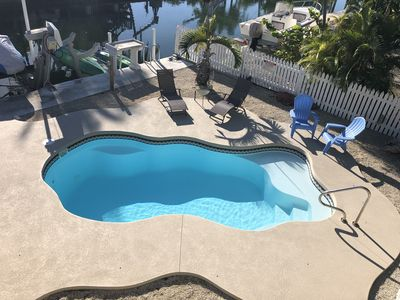 Photo for 5 Pirates Hideaway - Canal Front Home with Pool and Seawall for your boat