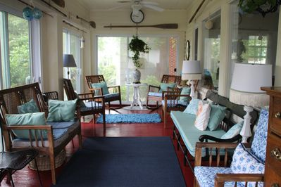 Walk into a beautiful screened-in front porch to sit and relax in. Lots of room.