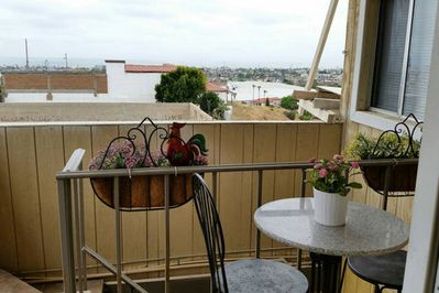 cute cozy balcony with  the setting table