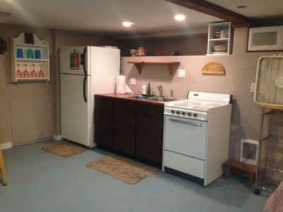 Kitchen complete with microwave, coffee maker, water kettle and blender.