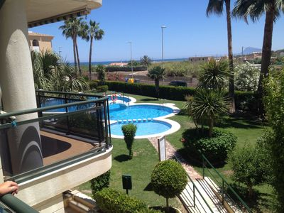 Photo for Perfectly situated 3 bed beach apartment with balcony overlooking swimming pool
