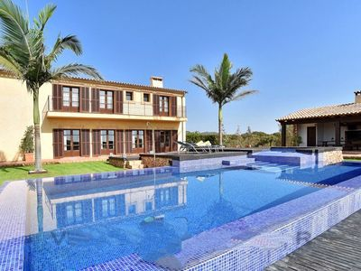 Photo for 4 bedroom Villa, sleeps 8 in s'Horta with Air Con and WiFi