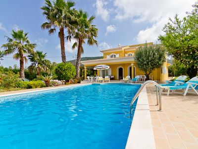 Photo for This 4-bedroom villa for up to 8 guests is located in Loule and has a private swimming pool, air-con
