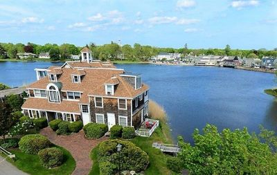 Photo for Stunning Waterfront Condo with deck, Walk to Shops and Restaurants