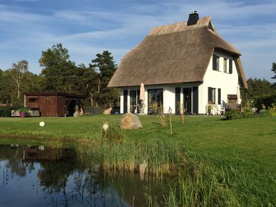Photo for Fantastic 5 ***** Thatched cottage on the water with sauna, outdoor Jacuzzi, fireplace u. v.