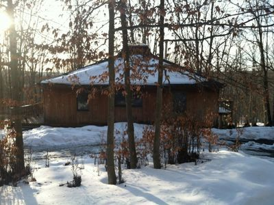 Photo for Cedar Haus - An eclectic cabin on a secluded wooded lot! Outdoor hot tub!
