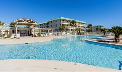 Photo for 4 nights in March left-Beachfront resort-heated pools-hot tubs-bikes-gym-tennis