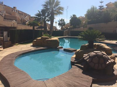Photo for Ground Floor Two Bedroom Apartment, Stunning Pool / AC / Free Wi Fi / TV / DVD