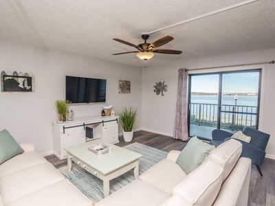 Photo for NEW! Updated condo w/open bay views, bayfront pool & 3 blocks to beach/boardwalk