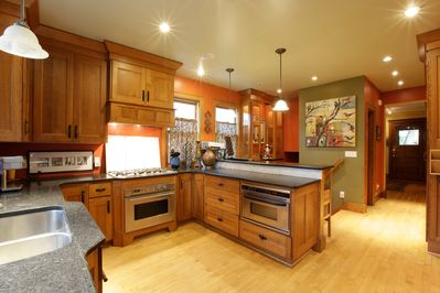 GREAT kitchen-lots of shelving, granite, stainless, and fully loaded