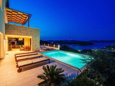 Photo for Villa with heated pool and sea views