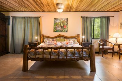 King-size bed, custom made with Laurelwood. Spacious and comfortable.