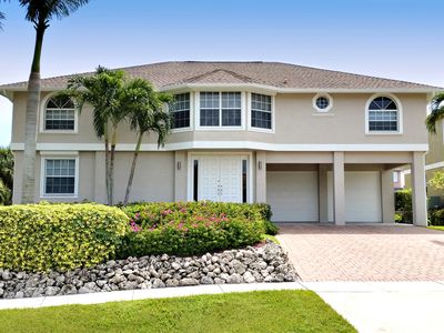 Photo for Walk to Beach, Restaurants, Shops, Movies. Water Front, Large Heated Pool, Dock