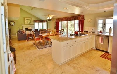 Upscale kitchen with top of the line stainless steal appliances and gorgeous granite counter tops.