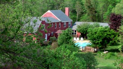 Great view of the Farmhouse and pool