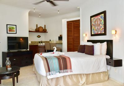 Amazing ocean view suite with queen size bed and kitchenette.
