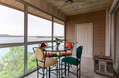 The screened in porch provides gorgeous views of the lake all year long!