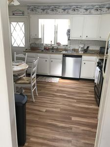 New floor and stainless steel appliances