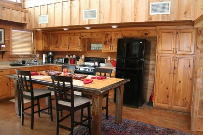 The kitchen and eating area,