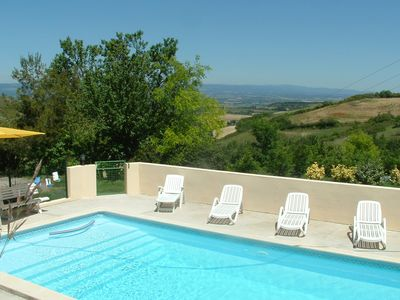 Photo for An old renovated farmhouse with a stunning vue, swimming heated pool & golf