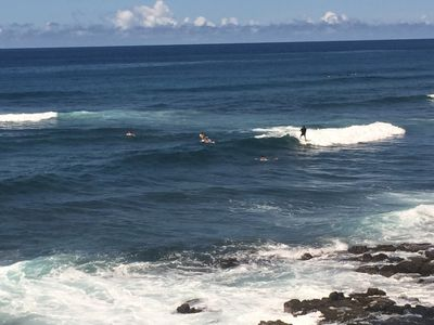 Watch surfers ride into shore from the lanai.