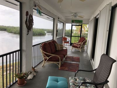 Photo for Eagles Nest- Corner canal front home with screened in balcony