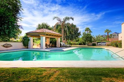 Pool - A covered patio with a dining table offers a great poolside spot for outdoor meals.